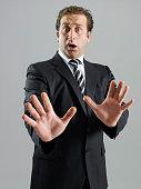 Businessman making a stop gesture