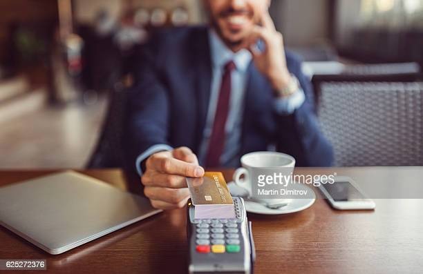 Businessman making contactless payment with credit card