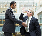 Businessman making face at co-worker