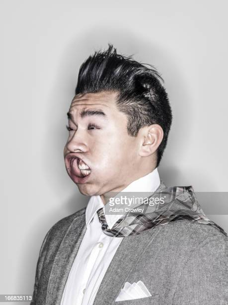 Businessman making face in wind