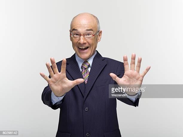 Businessman making hand gesture, portrait