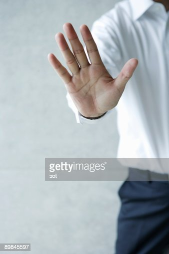 Businessman making hand gesture,close up
