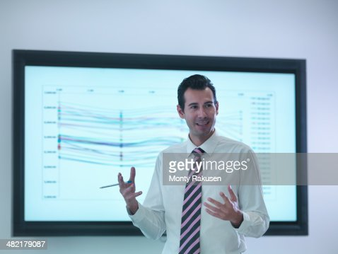 Businessman making presentation in front of screen