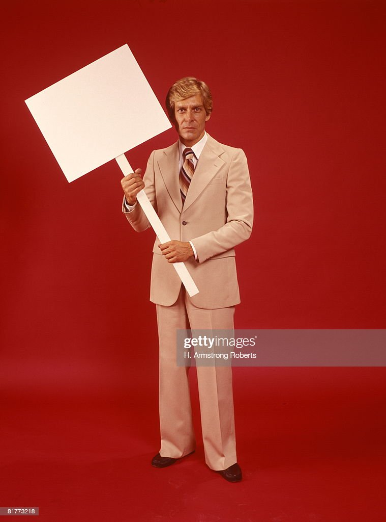 Businessman Man Suit Holding Blank Sign Placard Red Background Retro. : Stock Photo