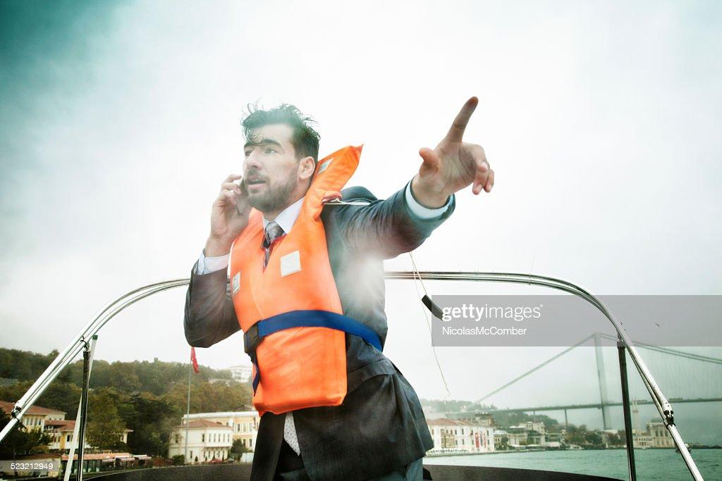 Businessman manages crisis in storm concept