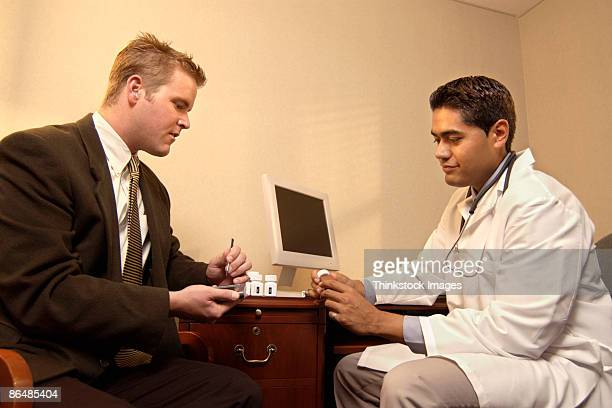 Businessman meeting with doctor