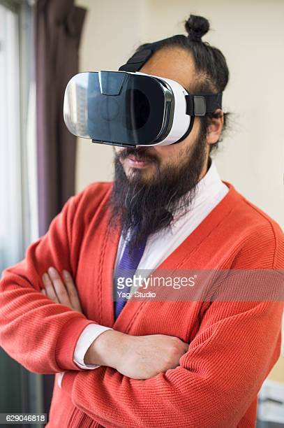 Businessman meeting with VR headsetat