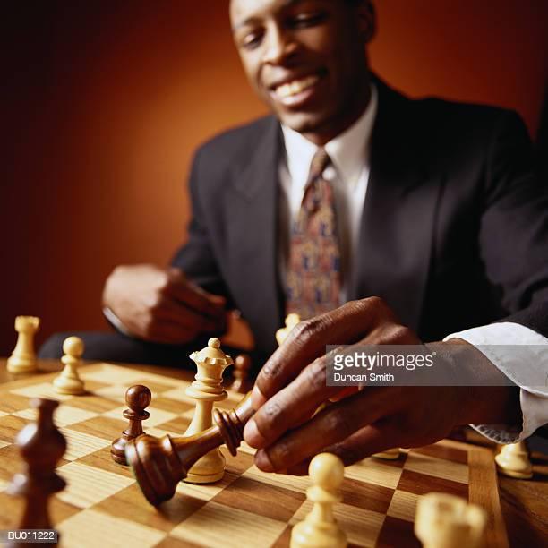 Businessman Moving a Chess Piece