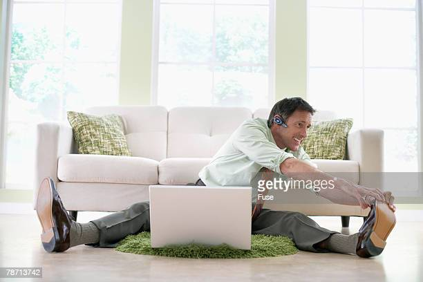 Businessman Multi-tasking at Home