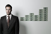 Businessman near a row of hundred dollar bills