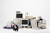 Businessman Next to Old Computers