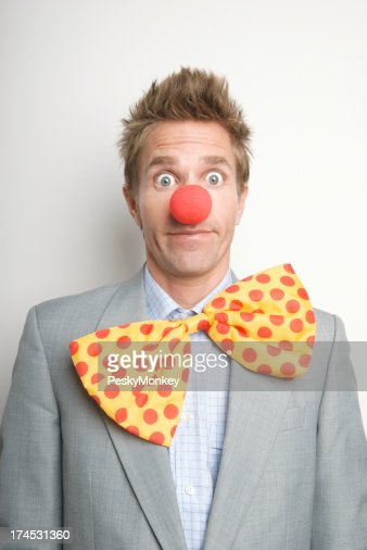 Businessman Office Clown with Red Nose and Bright Bow Tie