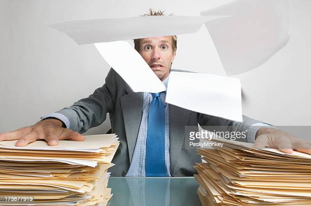 Businessman Office Worker Holds On to his Paperwork