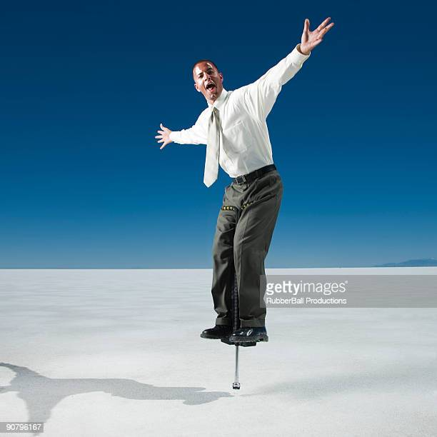 businessman on a pogo stick