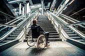 Businessman on a wheelchair against modern stairs. iStockalypse 2012 in Berlin.