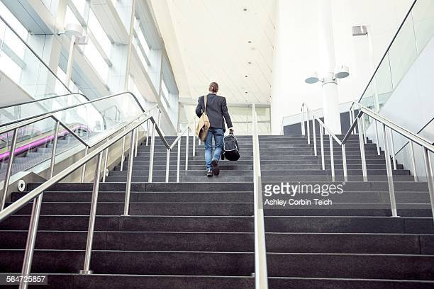 Businessman on business trip going up stairs, New York, USA