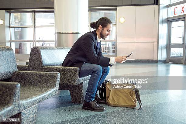 Businessman on business trip using digital tablet, New York, USA