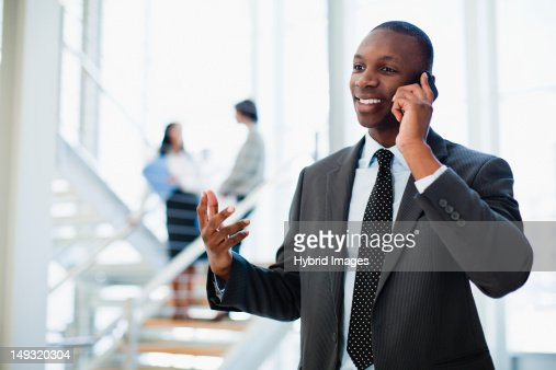 Businessman on cell phone in office : Foto de stock
