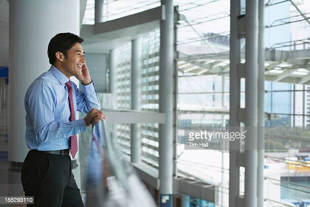 Businessman on cell phone in office