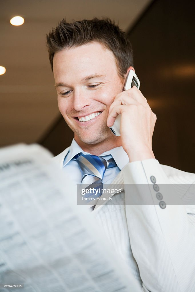 Businessman on cell phone : Photo