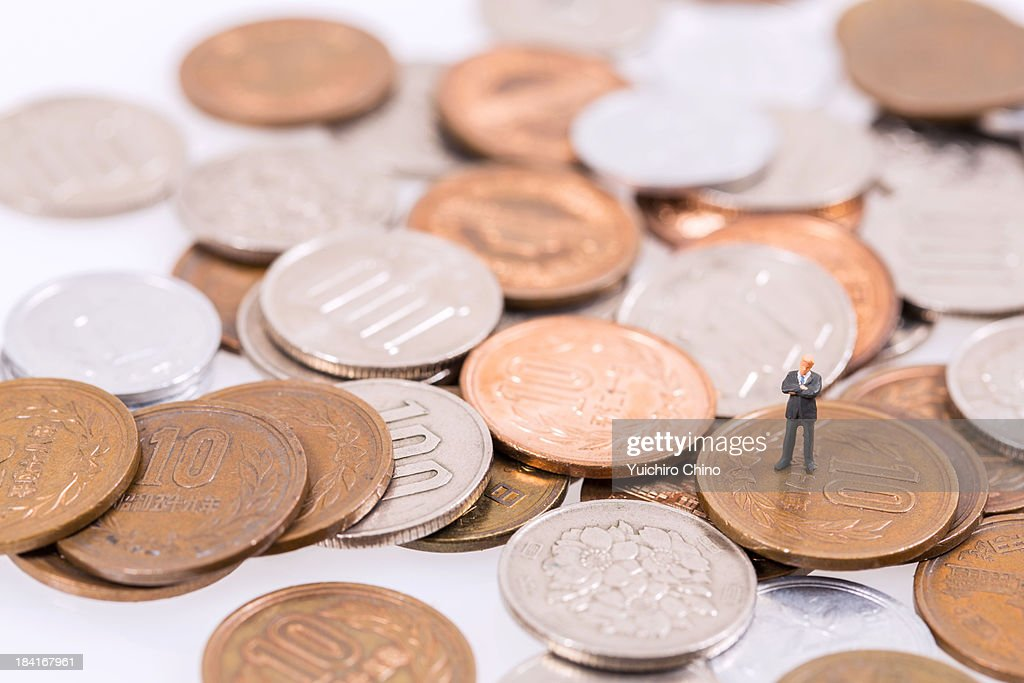 Businessman on Coins : Stock Photo