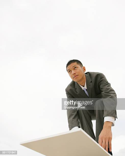 Businessman On Diving Board
