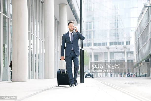 Businessman On His Cell Phone With Suitcase