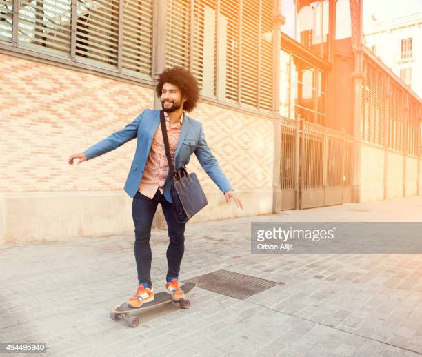 Businessman on longboard