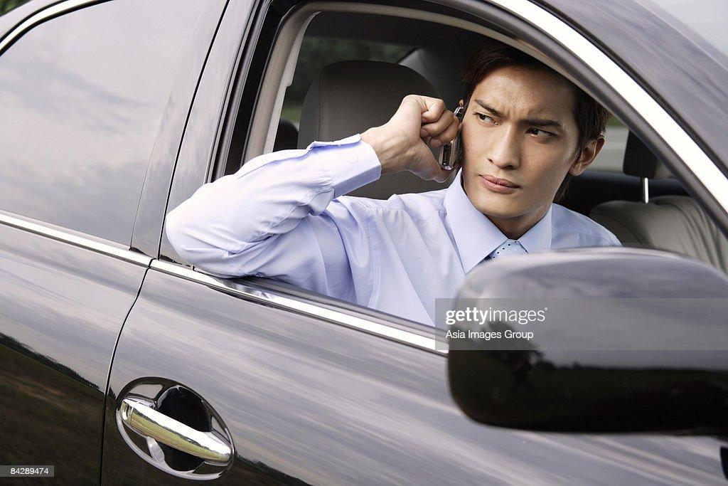 Businessman on mobile phone : Stock Photo