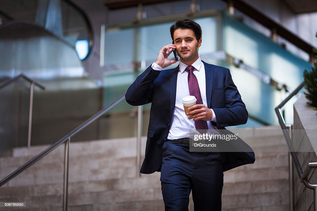 Businessman on phone running late