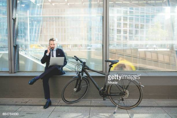 Businessman on phone using laptop