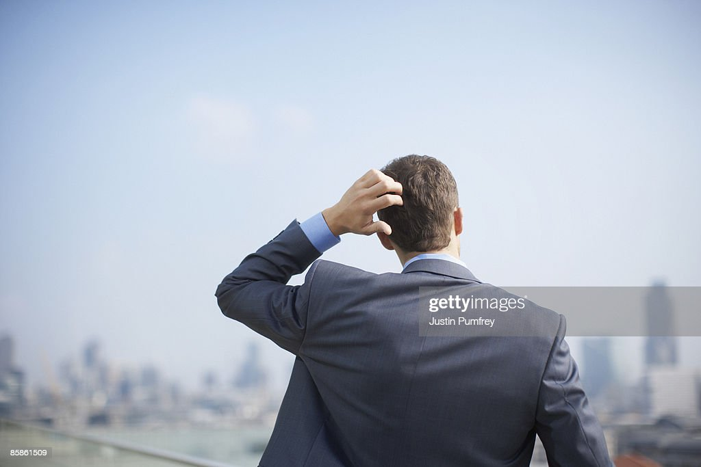 Businessman on rooftop, close up, rear view : Stock Photo