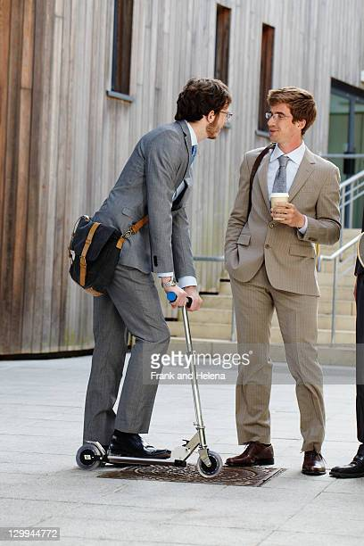 Businessman on scooter with colleague