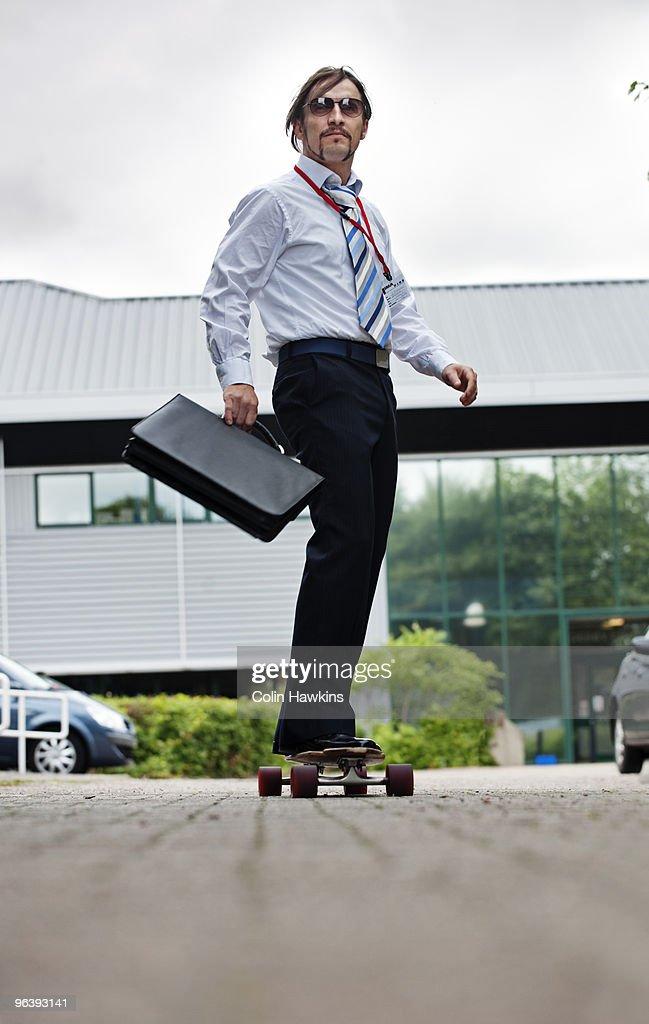 businessman on skateboard : Stock Photo