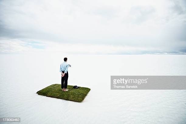 Businessman on small island in large body of water