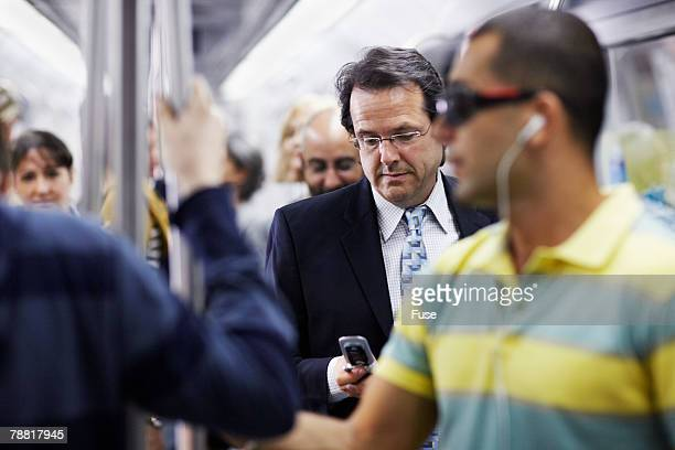 Businessman on Subway Text Messaging