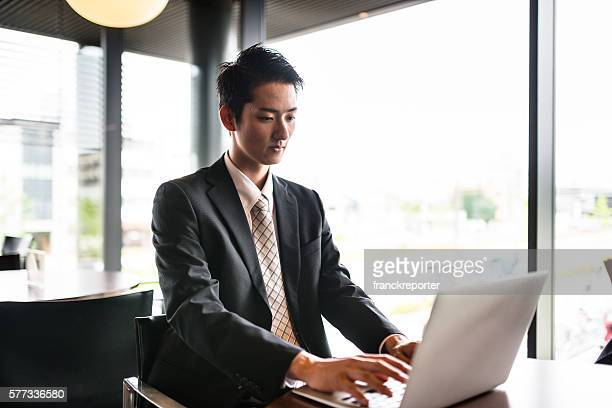 businessman on the computer in the office meeting hall