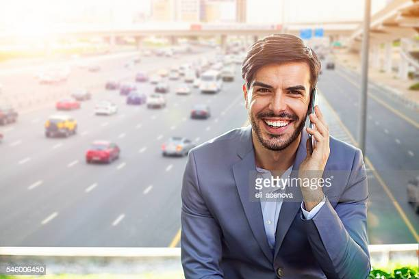 Businessman on the phone, Highway traffic in Dubai