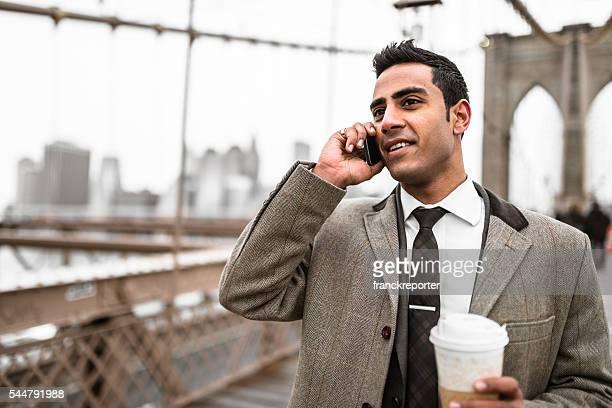 Businessman on the phone in brooklyn bridge