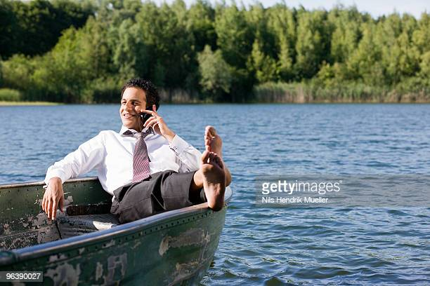 businessman on the phone in rowboat