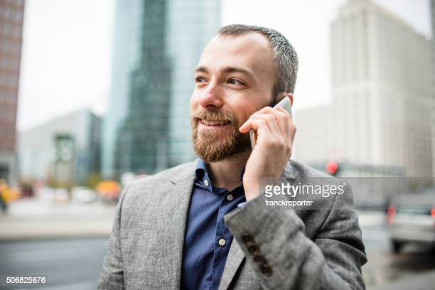 Businessman on the phone in the city