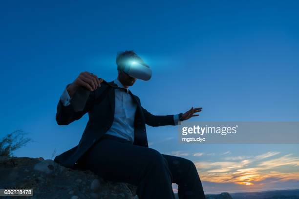 Businessman on the top of a high mountain