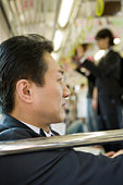 Businessman on the train, close up, differential focus