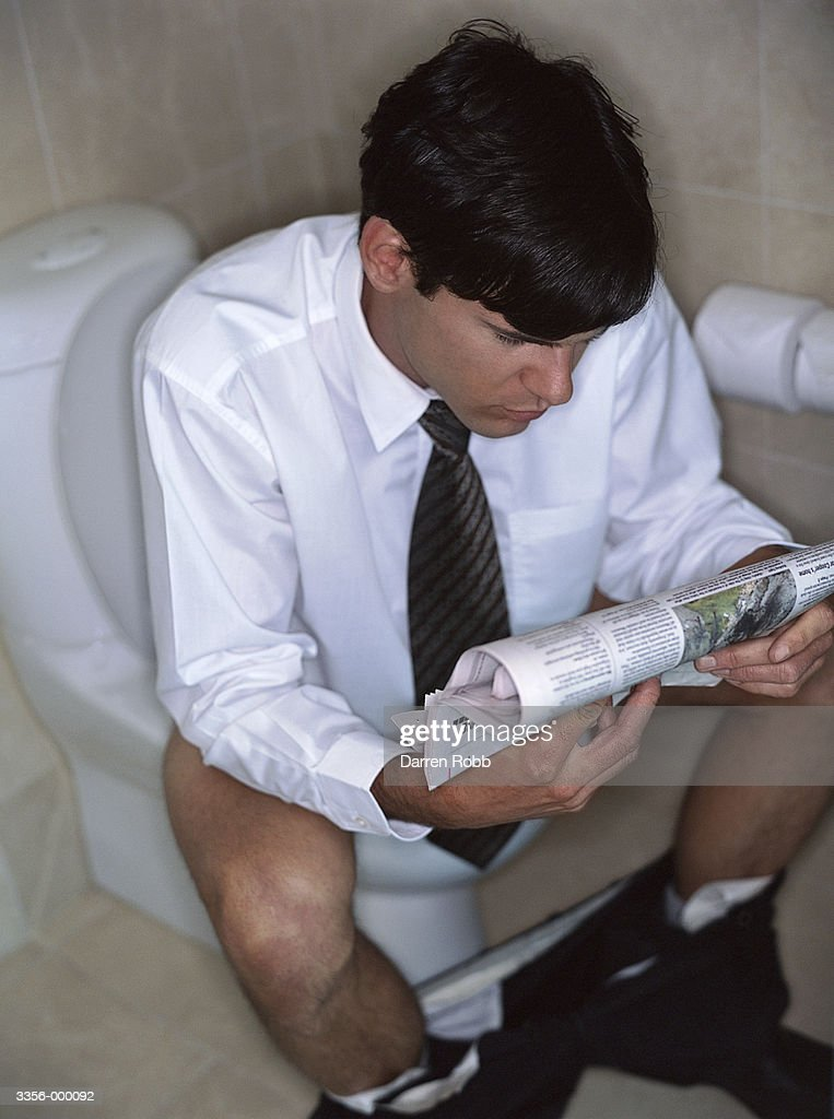 Businessman On Toilet Reading Stock Photo Getty Images