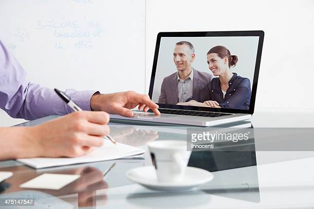 Businessman on video conference with two colleagues
