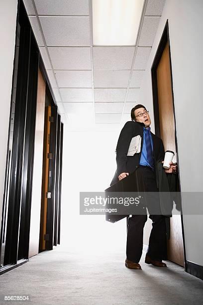 Businessman opening door