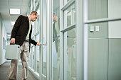 Businessman Opening Office Door