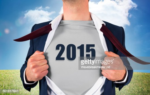 Composite image of businessman opening shirt in superhero style : Stock Photo
