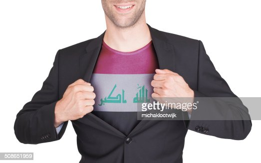 Businessman opening suit to reveal shirt with flag : Stock Photo