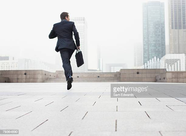 Businessman outdoors jumping